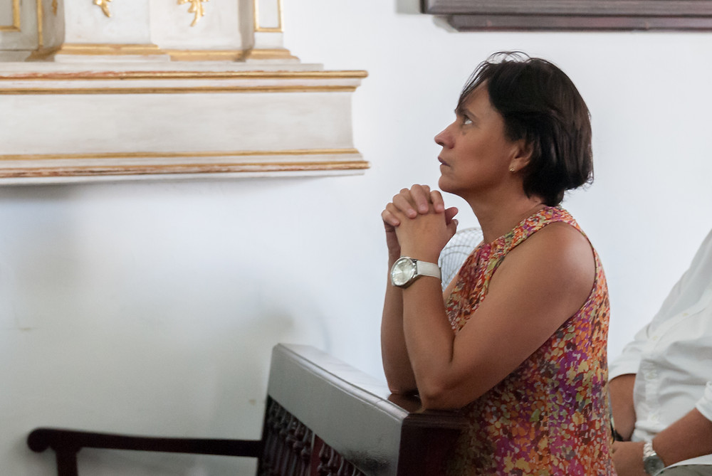 A woman praying in church