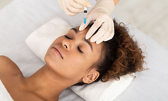 Woman being treated with Botox on face.