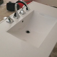 vanity top with Delta faucet