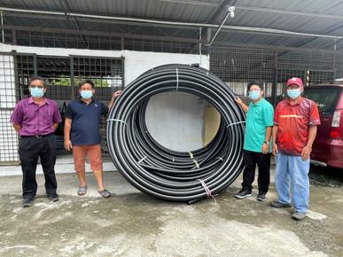 Ewon sampaikan keperluan bahan binaan kepada komuniti Kadamaian