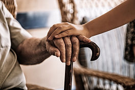 child-s-hand-old-man-s-hand-holding-cane