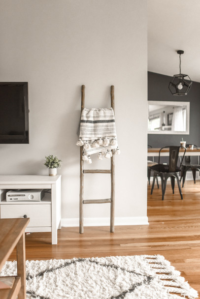 gray-wooden-ladder-on-white-painted-wall