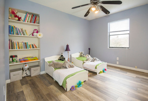 two-single-beds-beside-books-shelf-insid