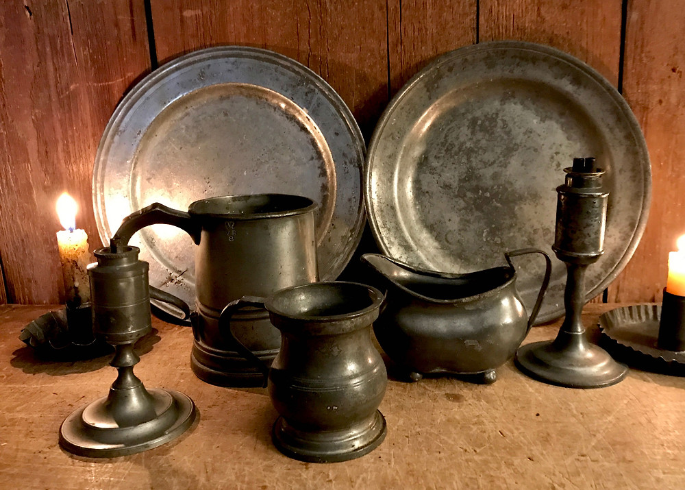 pewter plates, measures, oil lamps and a creamer