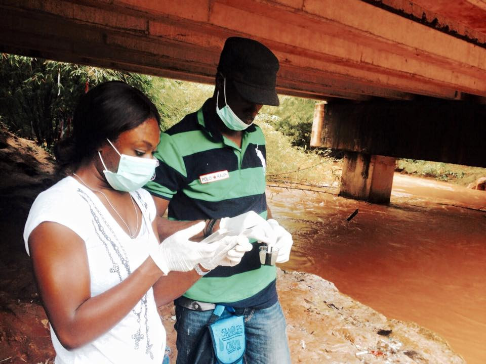 Exqusite Water Director Amanda Sunny and Nigeria Logistics Manager Kenechukwu Odimegwu testing water in a river near a rura village in Anambra State.