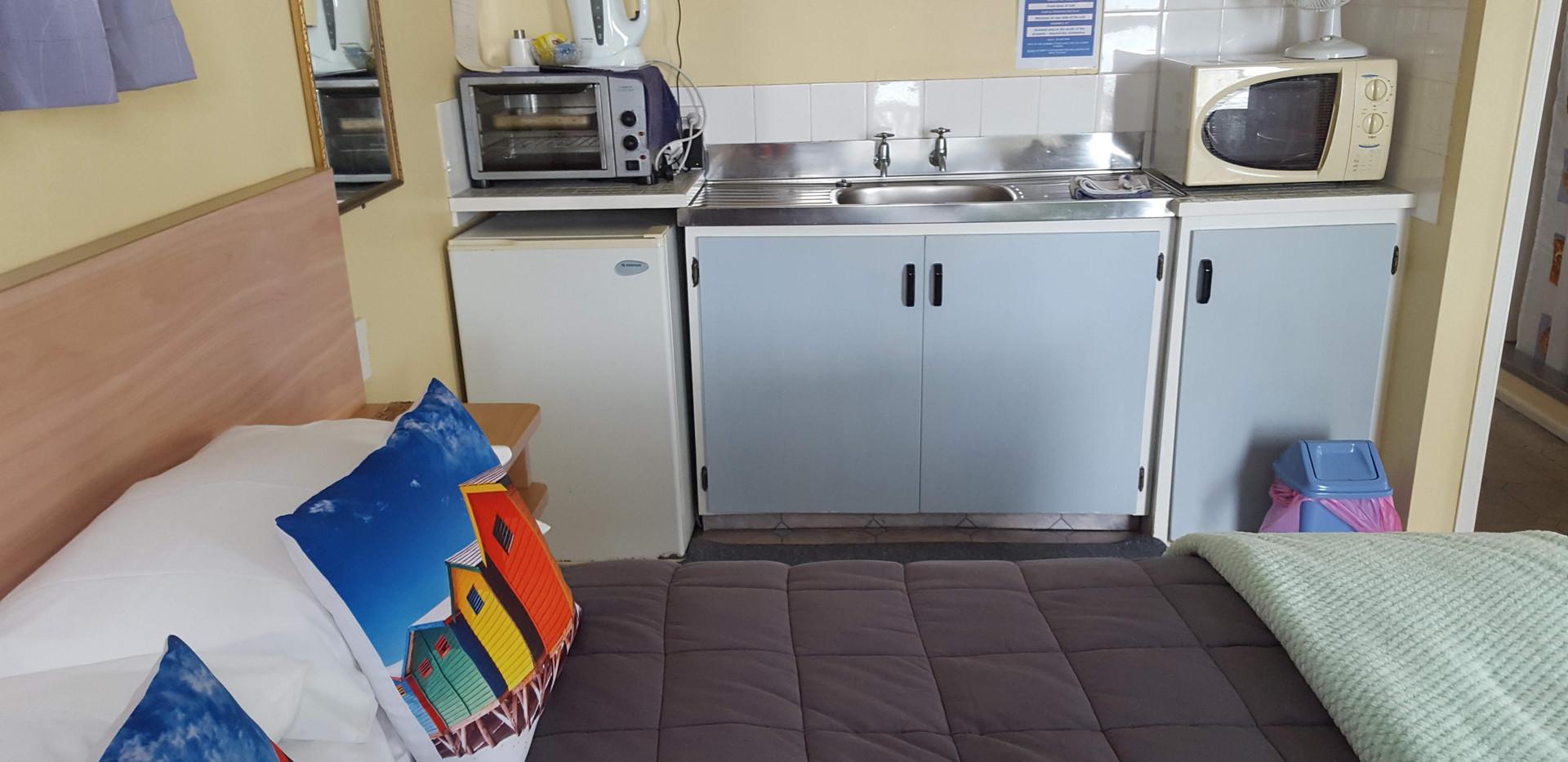 Studio unit at Seaspray Motel with retro kitchen