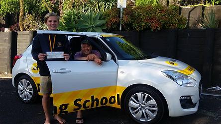 Student by driving school car with successful driving test result