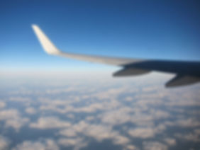 Aeroplane wing above the clouds