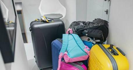 Pile Luggage in Front of Door- AxxNox