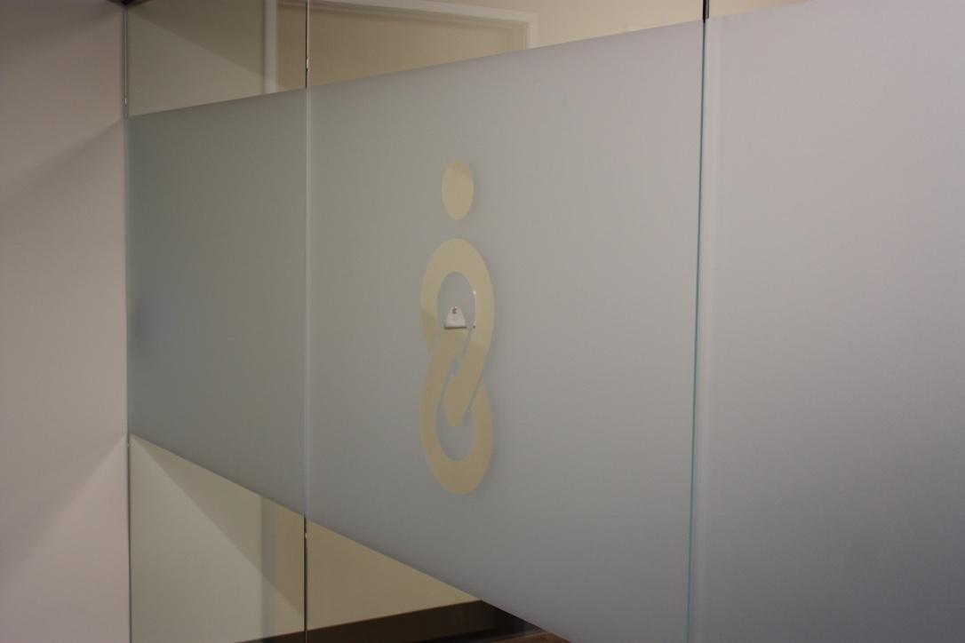 Company logo on glass wall