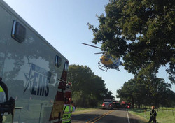 Star Flight on scene of motor vehicle accident - Coupland Engine 2 in background