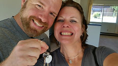 Couple with keys to house