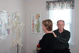 Dr. Philip LaPierre treating a client's shoulder with matrix repatterning