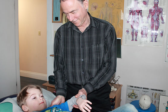 Dr. LaPierre working with a young lad's shoulder