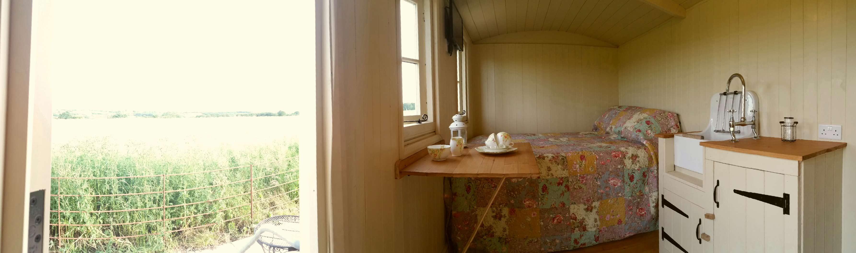Inside-Shepherds-Hut-Panoram-Bath-Garden-View
