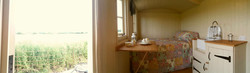 Inside-Shepherds-Hut-Panoram-Bath-Garden-View