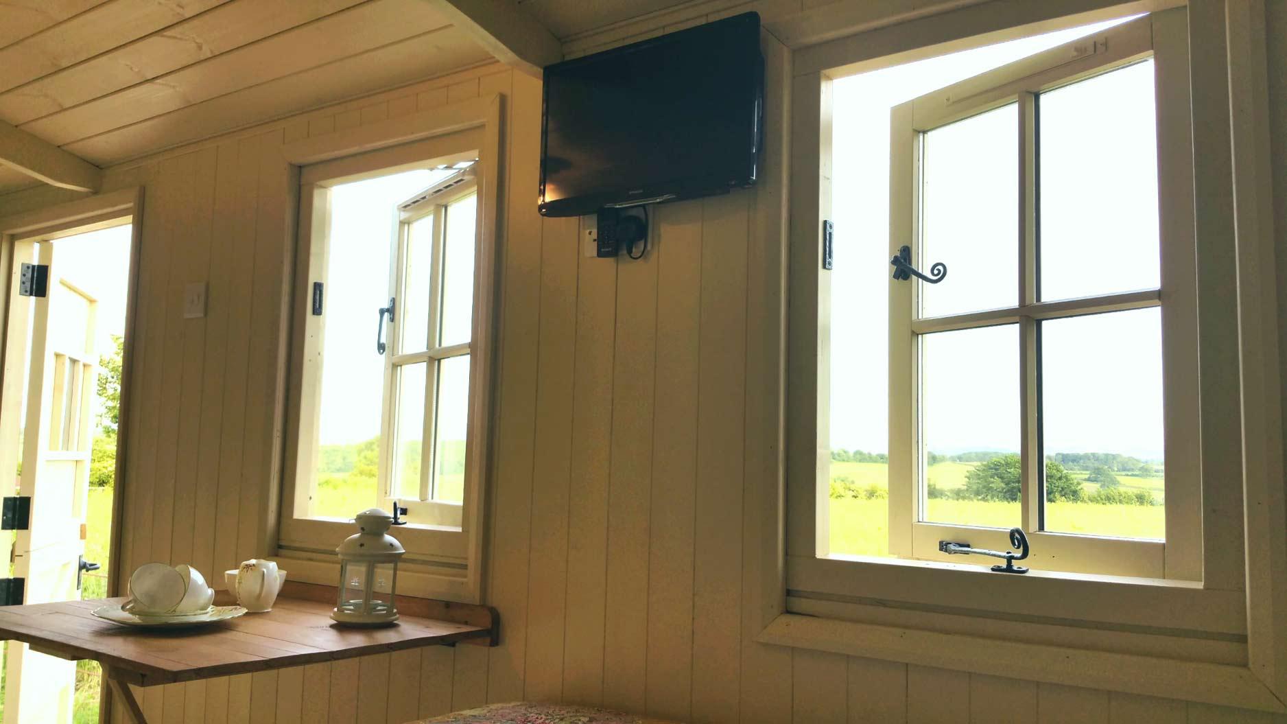 TV-and-View-Inside-Shepherds-Hut-Panoram-Bath