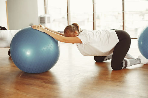 young-pregnant-woman-doing-stretching-ex