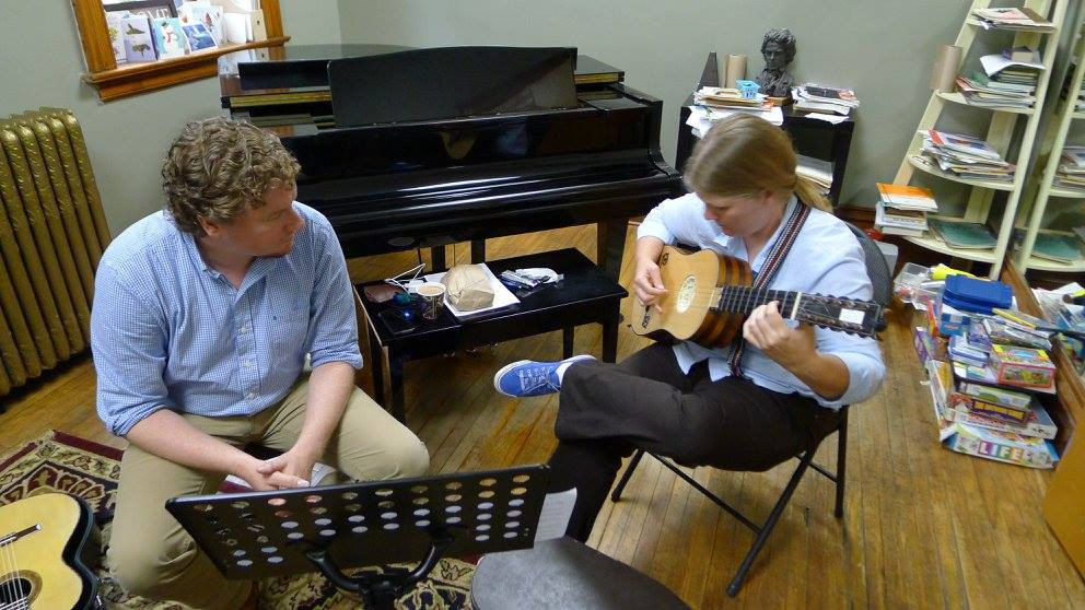Will Douglas teaching baroque guitarist, Kat Hammer.