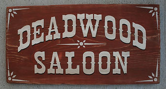 old west saloon sign