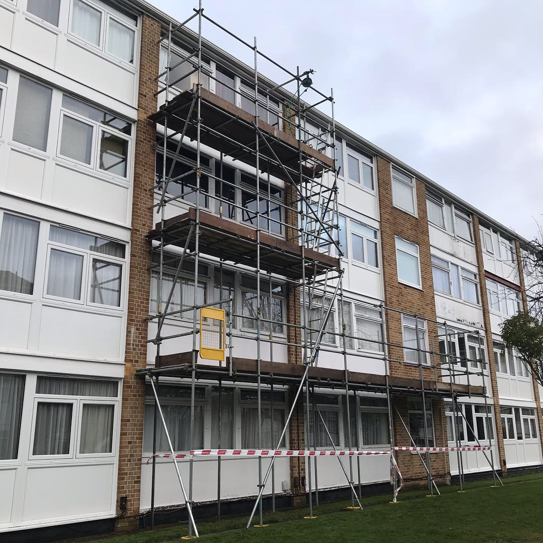 London scaffolding for repairs to wood panels and painting