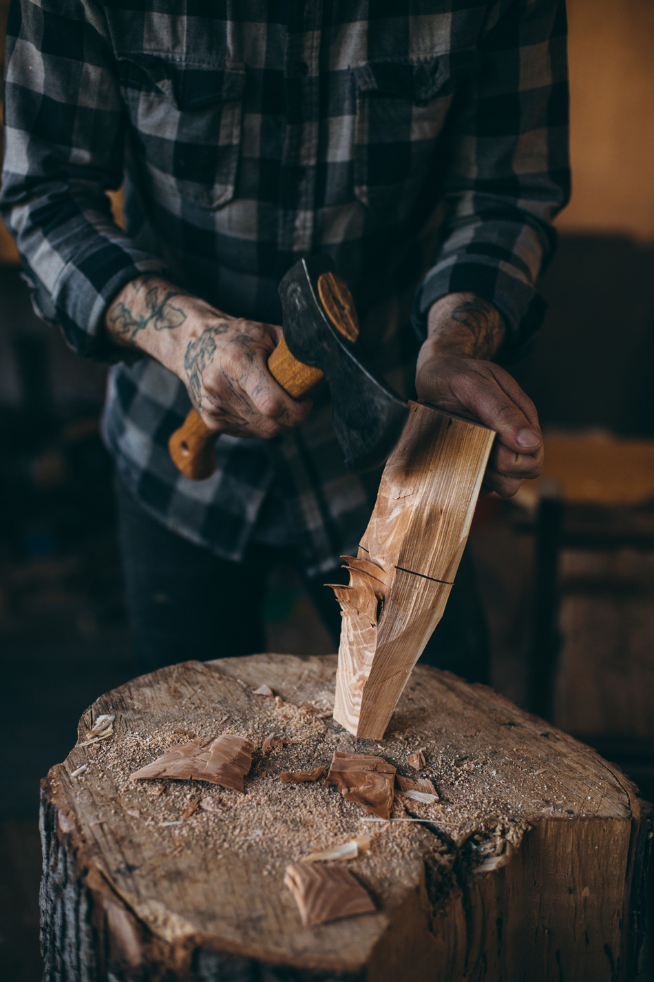 Roughing in the shape of the spoon with a hatchet