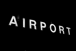 sign-airport-neon-illuminated-area.webp
