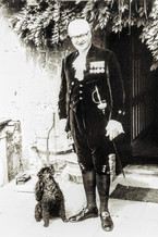 Denis Flower CBE. DL. in sheriff's outfit outside the manor