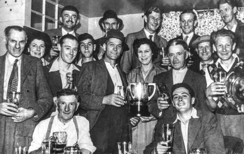 Red Lion darts team. Alf Morrell licensee 50s-60s. Back row: Bill Turville, Len Williams, F Williams, B Randle, Kelly Little. Middle row: A Morrell, B Morrell, Gerry Hanson, H Peachey, Bernard Peachey, Mrs Morrell, Fred Everett, Alf Davies, H Williams. Front row: A Hughes, F Everett