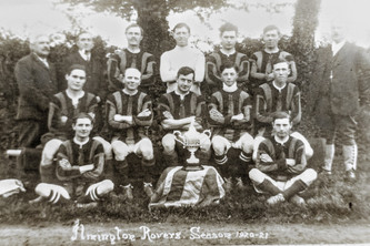 Ilmington Rovers1920-21. Back: John Handy, Tom Grumley, W Cooke, W Proctor, L Handy, J Cooke, ? Hurleston. Middle: J Handy, K Rouse, ?, H Wilkins, C Hands. Front: ? Taylor, N Hall