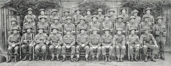 Home guard 1945 - Back row: Tommy Wilkins, Henry Ashby, Frank Clifford, Joe Rolfe, Sam Freeman, ?, ?, Charlie Mathews, Russell Sabin, Norma Hall, ?. Middle row: Charles Sabin, ?, Tom Berry, Bill Rolfe, Ern Downes, Johnny Hemming, Louis Wilkins, Bernard Wilkins, Bill Gayden, Bill Hall, Bernard Smith(?), Bob Cox. Front row: Bert Empson, Diggy Digweed, Jim Handy, Sam Handy, Captain Learmouth(?), Major Rodykernacki(?), ?, Captain Livingstone(?), Lt Carte, Stan Mathews, Jack Vincent, Bob Spencer
