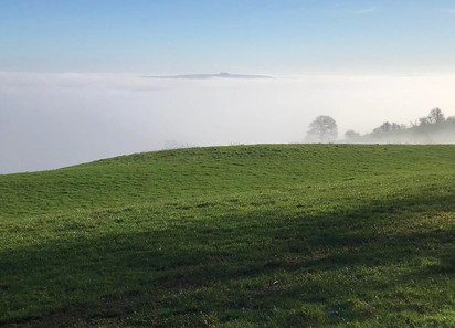 Brailes Hill through the January mist at the top of Foxcote Hill