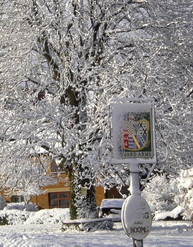 Winter. Howard Arms Sign in Snow
