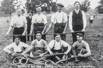 Tug of war team at Foxcote fete 1925(?). Top row: Jim Baker (Blockley or Ebrington), Jack Cooke, Bill Cooke, ?. Bottom row: Sid Cooke, Fred Dumbleton,?, ?. George Cook in background