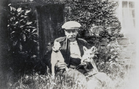 'Hobble' Cook with terrier & fox cub