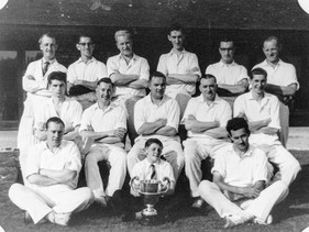 Ilmington cricket club 1957. Back: Sid Distoi, David Dowler, E Warrington,John Bryan, Richard Hall, Bill Randall. Middle: Anthony Empson, Peter Hall, Ted Freeman, Ron Grimley, Michael Empson. Front: J Hanson, Gary Hanson, Ron Davies