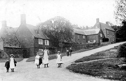 Children standing at the bottom of Foxcote Hill, Ilmington. 1900s