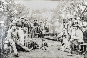 The pig roast 1895/96 - Thomas Foster sitting on right, his two daughters on the ground to his right, possibly Emily & Amelia