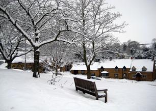 Snowy bench upper green