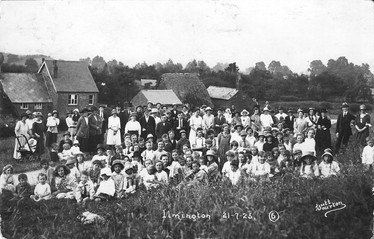 Ilmington 21/7/1921. Taken on Upper Green looking towards Front Street with Daisy Cottage & Mizpah. (NB Sam Bennett with arms around two ladies top right)