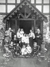 Biles family outside Village hall 1930s