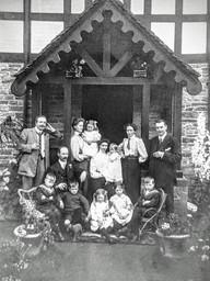 Biles family outside Village hall 1930s