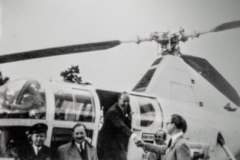 John Profumo arriving by helicopter in Berry orchard, greeted by Dennis Flower
