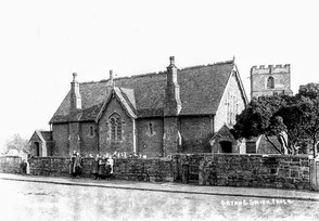 Ilmington village school with pupils standing behind wall