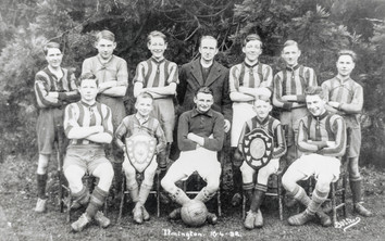 Ilmington football team 16-4-32. Back row: Ingles, Davidson, Wilson, Rev Edge, L Ganley, J Barnes, M Bubb. Front: G Biles, B Wyton, Frank Boswell, Ron Gormley, G Barnes