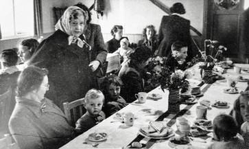 Coronation tea in village hall, June 1953. Mrs Spenser Flower behind her grandchildren Martin & Robin Taylor and left of them Nannie Wise