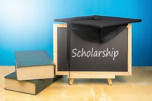 Graduation hat, books, blackboard with t