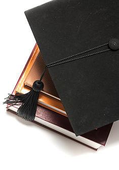 bigstock-Graduation-Cap-And-Book-9441739