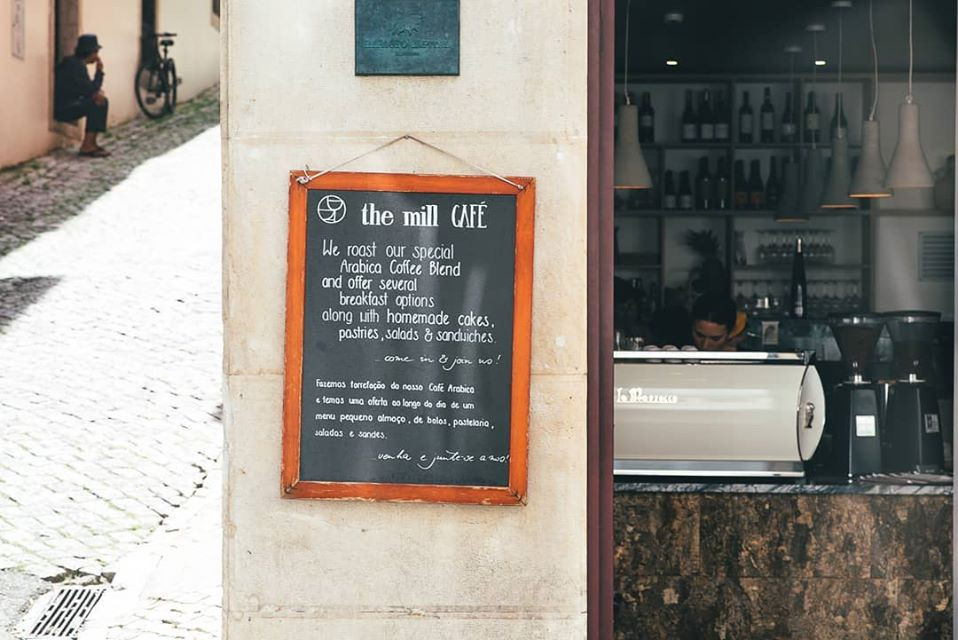 The Mill Cafe shop front in Lisbon, Portugal.