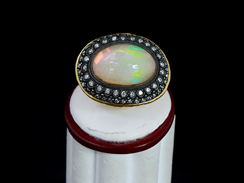 Gold Ring with Opal Centerpiece